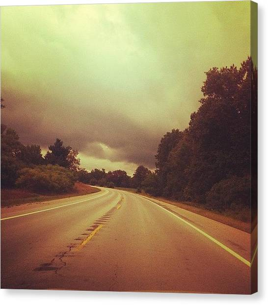 Rainclouds Canvas Print - Road by Cassie OToole