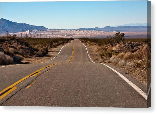 Road To Kelso Dunes Canvas Print by Dennis Hofelich