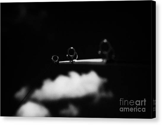 Rod And Line Fishing Against Sky Canvas Print by Joe Fox