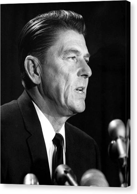 Ronald Reagan At A Press Conference Canvas Print by Everett
