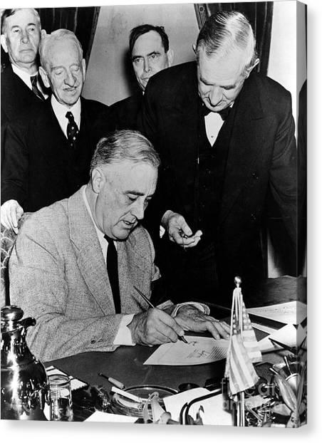 Franklin D. Roosevelt Canvas Print - Roosevelt Signing Declaration Of War by Photo Researchers