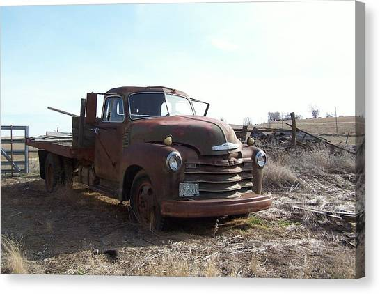 Rusty Abandoned Chevy Truck Canvas Print by Richard Adams