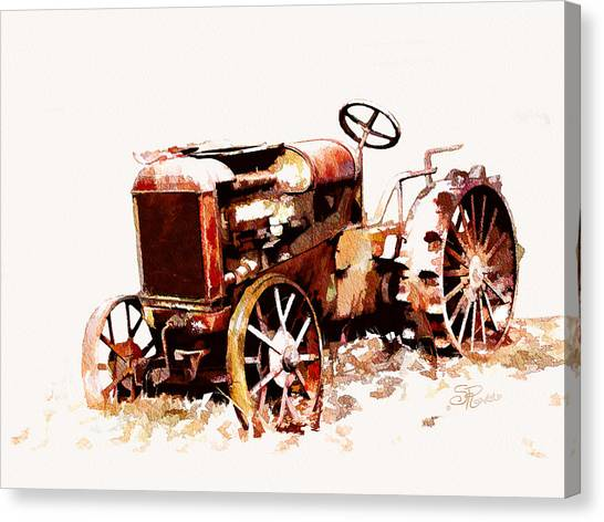 Rusty Tractor In The Snow Canvas Print