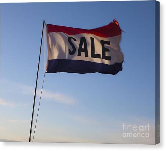 Sale Flag In The Wind Canvas Print by Paul Edmondson