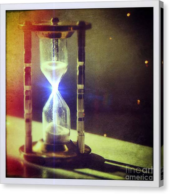 Sand Through Hourglass Canvas Print