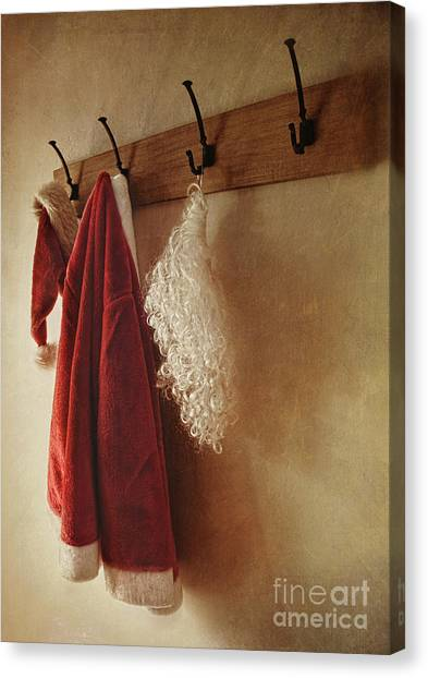 Santa Costume Hanging On Coat Rack Canvas Print