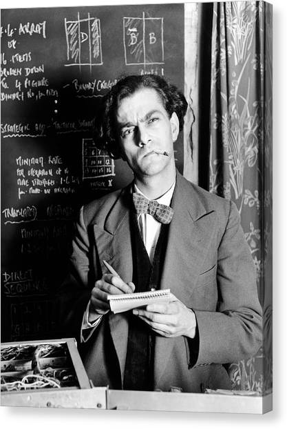 Scientist By Blackboard Covered In Equations (b&w) Canvas Print by Hulton Archive