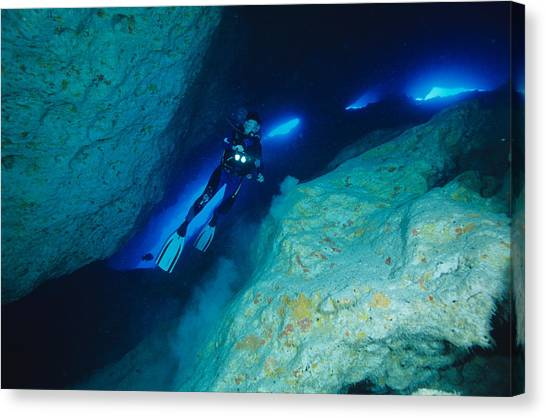 Underwater Caves Canvas Print - Scuba Diver In A Cave by Alexis Rosenfeld