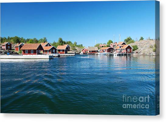Seaside Red Cottage Canvas Print by Conny Sjostrom