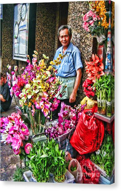 Selling Flowers In Chinatown Canvas Print by Anne Ferguson