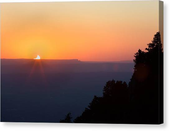 Setting Eclipsed Canvas Print