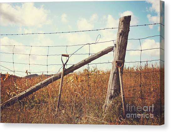 Shovels Leaning Against The Fence Canvas Print