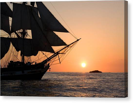 Silhouette Of Tall Ship At Sunset Canvas Print