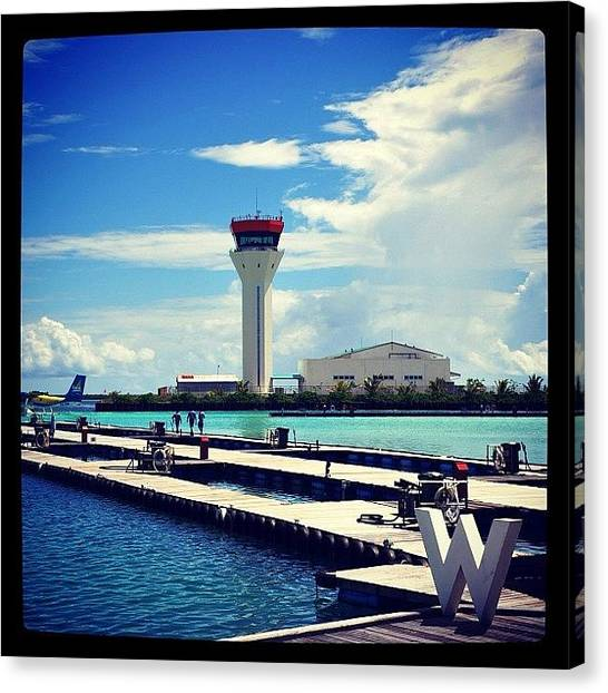 Seaplanes Canvas Print - #sky #clouds #sea #jetty #seaplane by Mohamed Shafy
