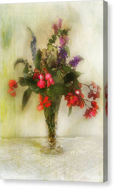 Small Vase Of Flowers Canvas Print by John Rivera