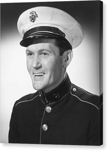 Smiling Man In Military Uniform Posing In Studio, (b&w), Portrait Canvas Print by George Marks