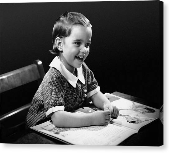 Smiling Young Girl Reading Book Canvas Print by George Marks