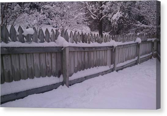 Snow Along A Fence Canvas Print by Jeannette Brown