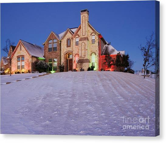 Snow Covered Yard And Stone House Canvas Print by Jeremy Woodhouse
