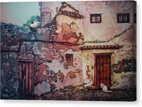 Spanish Courtyard Canvas Print by Leslie Redhead