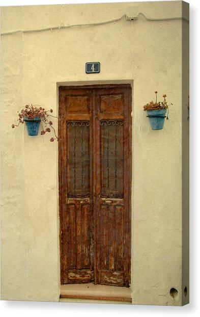 Spanish Doorstep Canvas Print by Perry Van Munster