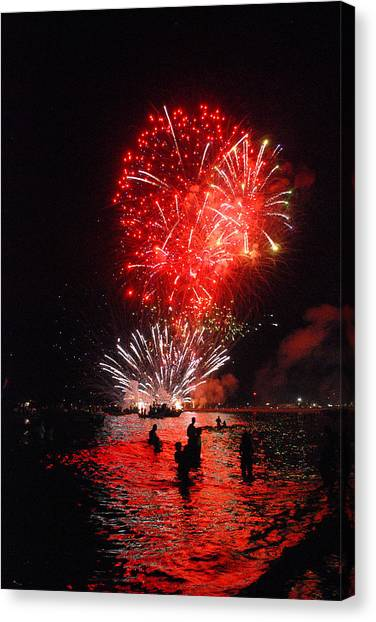 Sparks On The Sea Canvas Print by Perry Van Munster