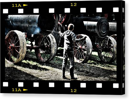 Stoking The Fire Canvas Print