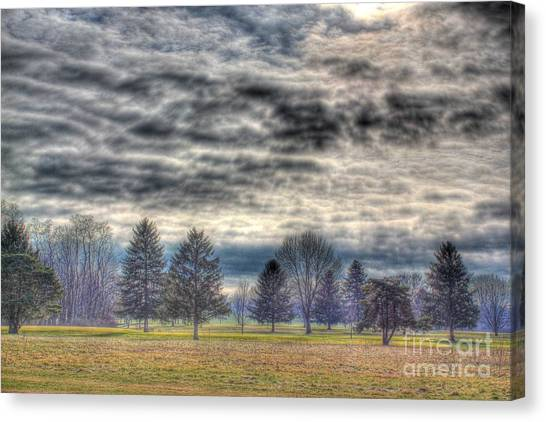 Storm Brewing Over Park Canvas Print