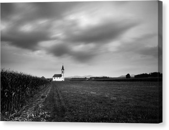 Storm Clouds Gather Over Church Canvas Print