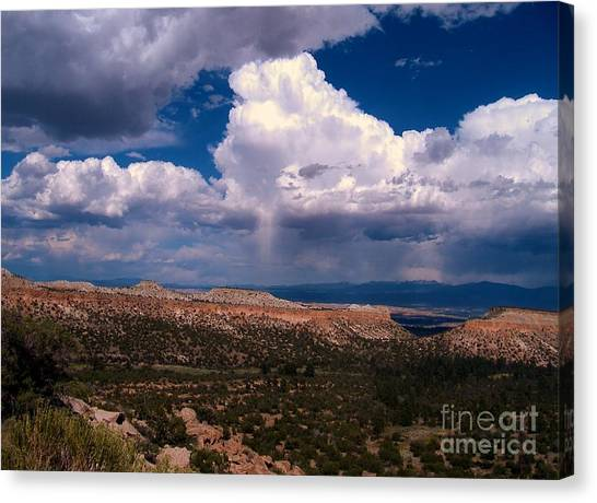 Storm Clouds Over Bandalier National Monument Canvas Print by Donna Parlow