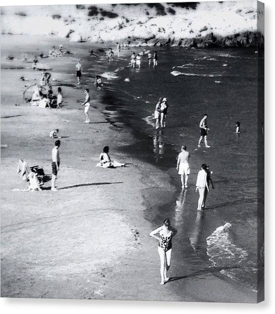 Swimming Canvas Print - Strangers On The Beach by Ric Spencer