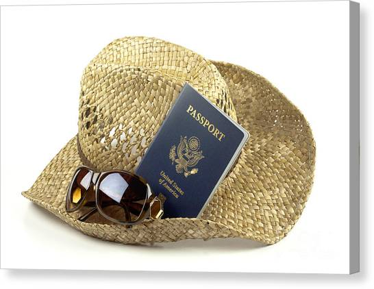Straw Hat With Glasses And Passport Canvas Print by Blink Images