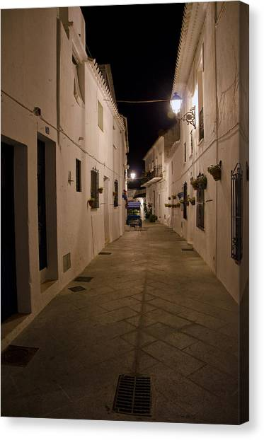 Street In A White Village Canvas Print by Perry Van Munster