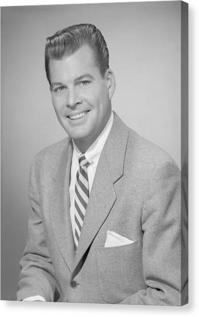 Studio Portrait Of Mid Adult Man Smiling Canvas Print by George Marks