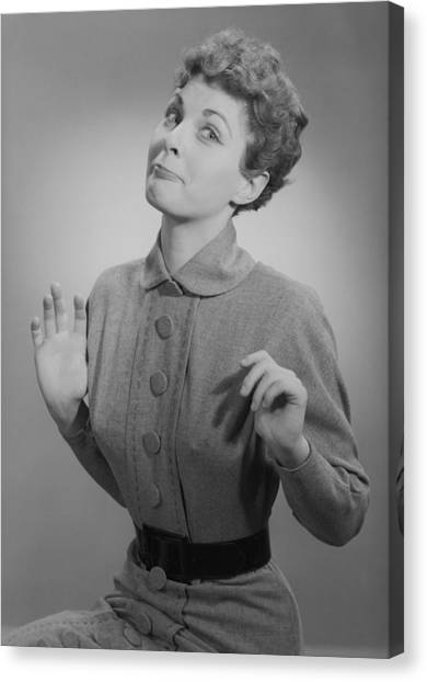 Studio Portrait Of Mid Adult Woman Making Face Canvas Print by George Marks