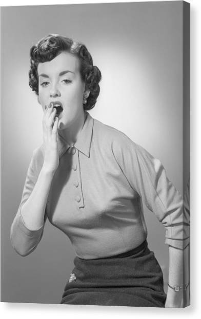 Studio Portrait Of Woman Yawning Canvas Print by George Marks