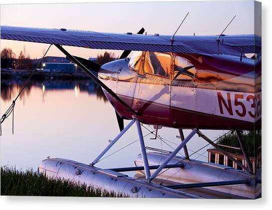 Cessnas Canvas Print - Sun Light On A Float Plane by Tim Grams