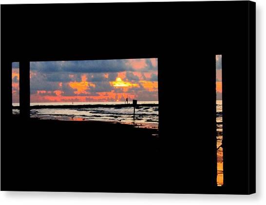 Sun Rise From Under The Pier Canvas Print by Mark Longtin