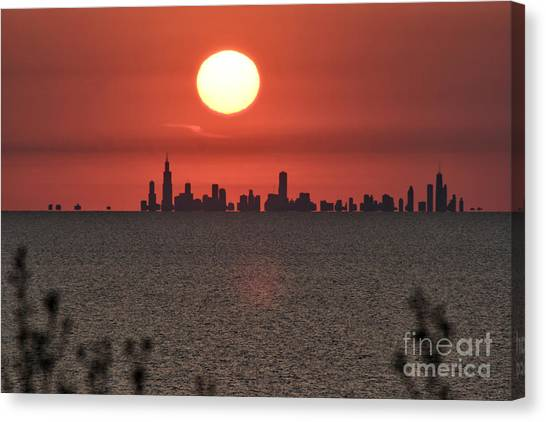 Sun Setting Over Chicago Canvas Print by Christopher Purcell