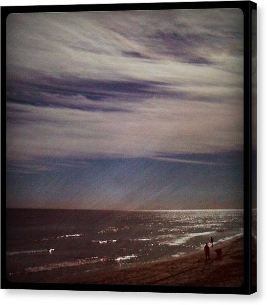 Surrealism Canvas Print - Sunny Winter Day. #ocean #beach #surf by Emily W