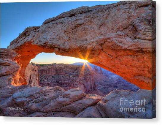 Sunrise At Mesa Arch Canvas Print
