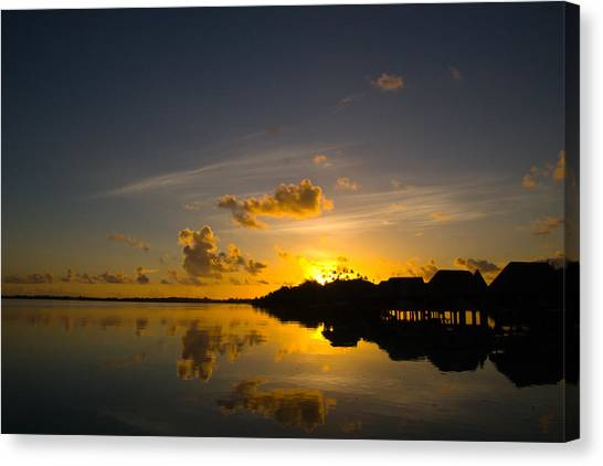 Sunrise In Bora Bora With Overwater Bungalows Canvas Print by Benjamin Clark