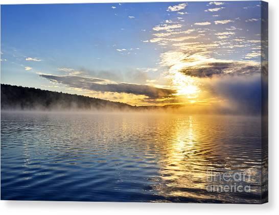 Lake Sunrises Canvas Print - Sunrise On Foggy Lake by Elena Elisseeva