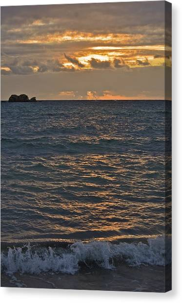 Sunrise On The Ocean Canvas Print by Nancy Rohrig