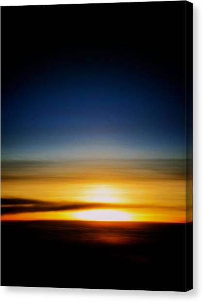 Sunset Above The Clouds Canvas Print by Jyotsna Chandra