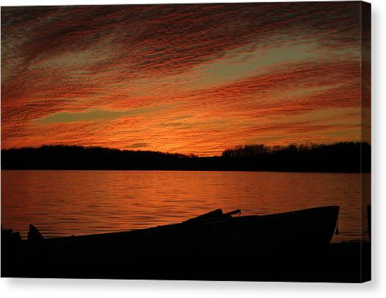 Sunset And Kayak Canvas Print
