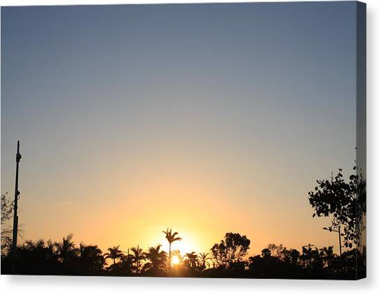 Sunset In Paradise Canvas Print by Nicholas Lowcock