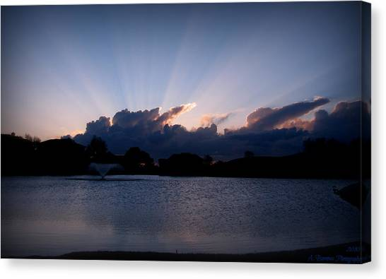 Sunset Light Rays Over The Pond Canvas Print by Aaron Burrows