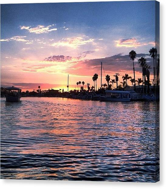 Palm Trees Sunsets Canvas Print - Sunset On The Water 2 by Trudy Eichen