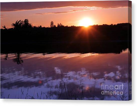 Sunset Over The Island Canvas Print by Sophie Vigneault